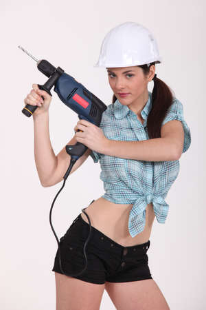 arousing: sexy woman using a power drill Stock Photo