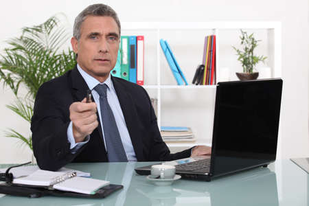 chief: A businessman in his office Stock Photo