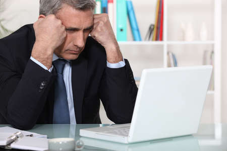 work experience: Businessman concentrating on his laptop