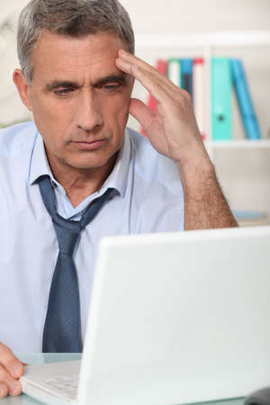 discouraged: Pensive man at the computer Stock Photo