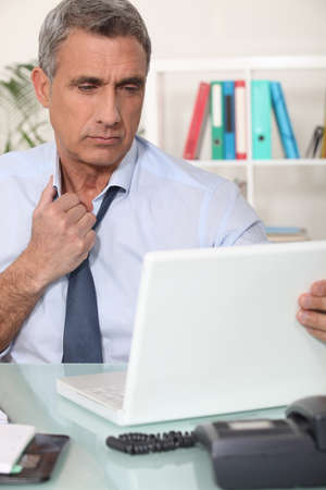 A tired corporate man. Stock Photo - 14195093