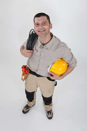 Electrician with a reel of cable photo