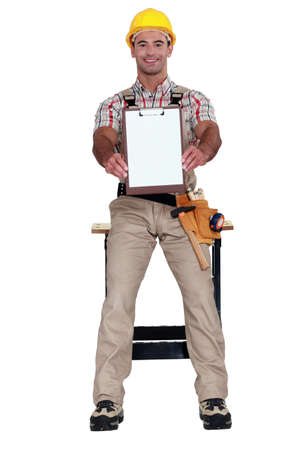 engineer's: Worker holding clip-board