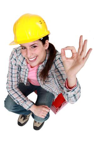 Tradeswoman giving the a-ok sign Stock Photo - 14195342