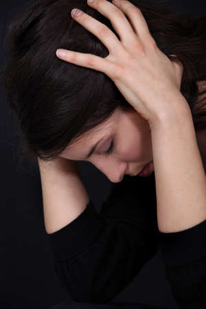 Woman holding head in pain