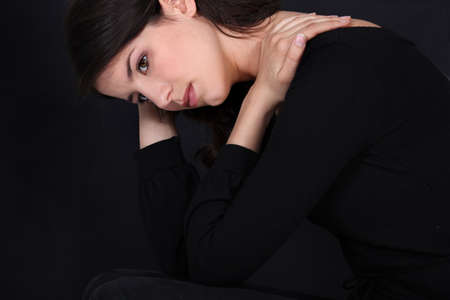 wistful: Wistful woman in black
