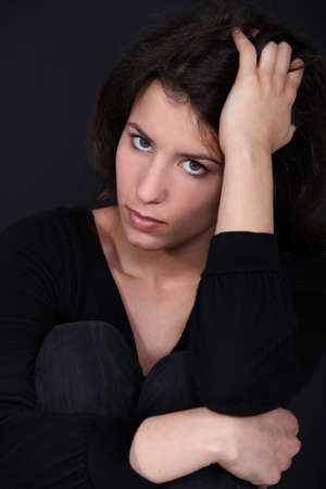 young woman looking sad photo
