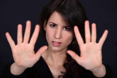 blockade: Woman holding her palms up Stock Photo
