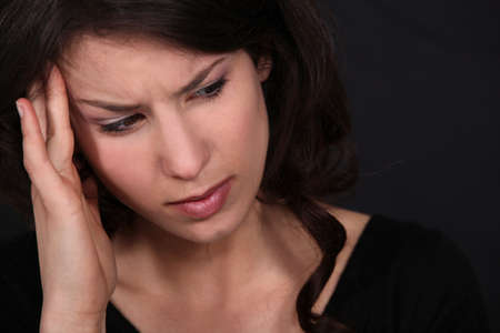 woman having a headache Stock Photo - 14194797