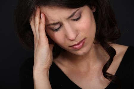 splitting headache: Women suffering from headache Stock Photo
