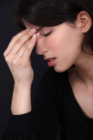 rubbing noses: Woman with a headache Stock Photo