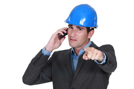 Architect pointing whilst on the telephone Stock Photo - 14194884