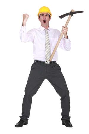 Architect with axe celebrating photo