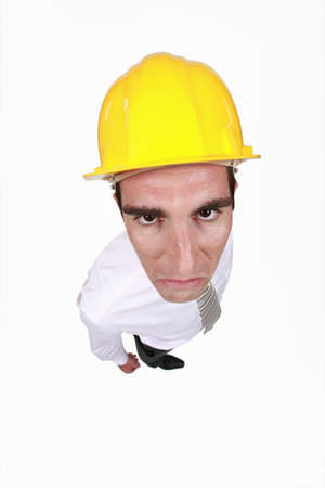 choleric: angry businessman wearing a helmet