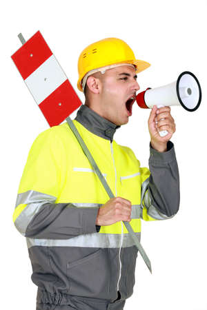 Laborer screaming in a bullhorn photo