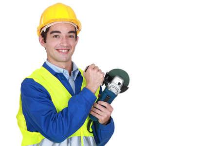 sander: Smiling laborer holding sander Stock Photo