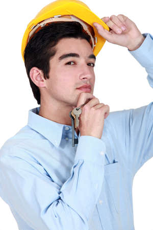 A construction worker holding a  set of keys. photo