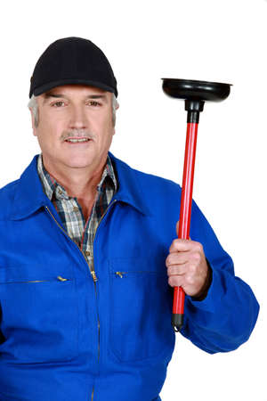 plunger: mature plumber holding plunger Stock Photo