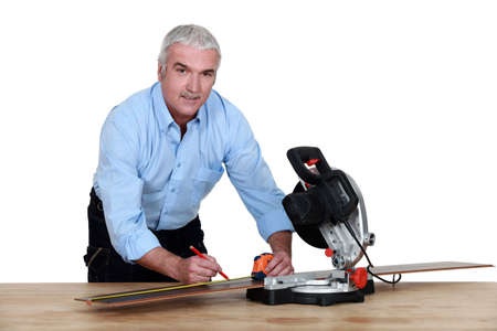 Man using a mitre saw photo