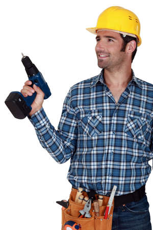 A handyman with a drill. Stock Photo - 14195056