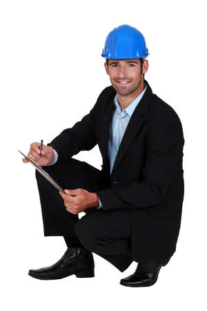 Engineer writing on a clipboard Stock Photo - 14193768