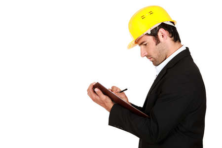 surveying: Surveyor writing on a clipboard