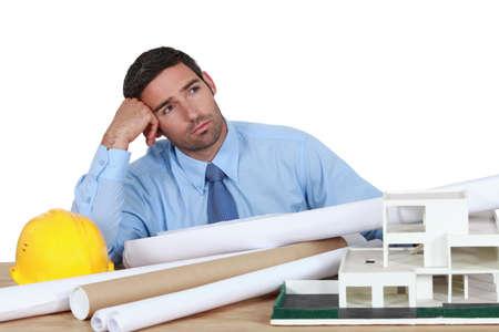 dullness: Bored architect sat at desk
