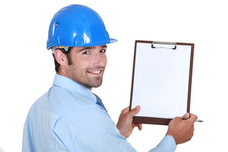 Architect holding clip-board and pen Stock Photo - 14195424