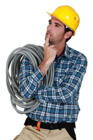 Pensive electrician photo