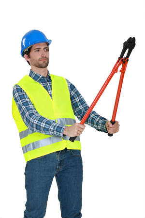 pry: Builder staring at bolt cutters Stock Photo