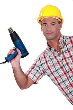 qualified worker: craftsman holding a drill Stock Photo