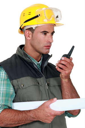 foreman with blueprints holding talkie walkie Stock Photo - 14195043