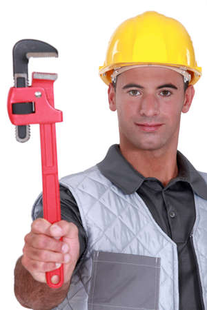 Man with a heavy duty adjustable pipe wrench Stock Photo - 14195121