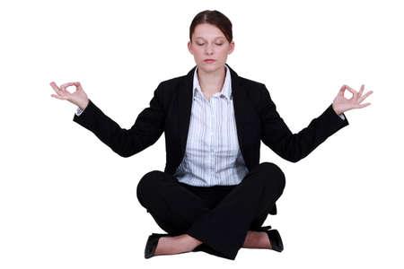 businesswoman suit: Empleado se relaja en una posici�n de yoga