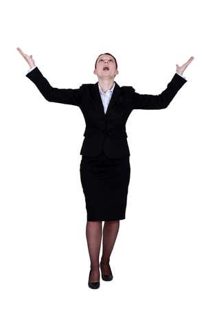 praise god: Woman praying for good fortune Stock Photo