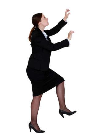 willingness: woman climbing Stock Photo