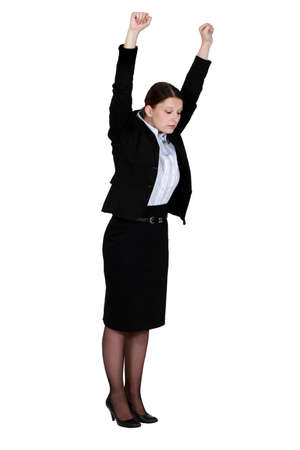 Businesswoman stretching at work photo