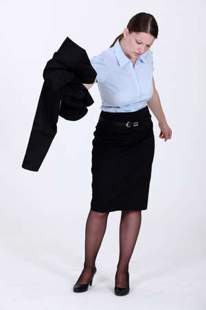 A businesswoman getting rid of her jacket. Stock Photo - 14194699