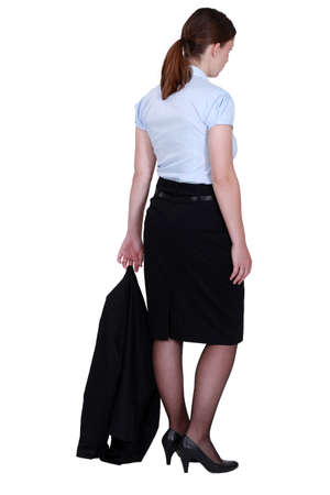 skirt suit: young secretary with jacket trailing behind her Stock Photo