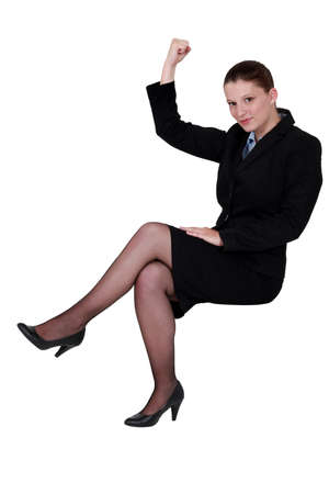 businesswoman lifting arm to show strength photo