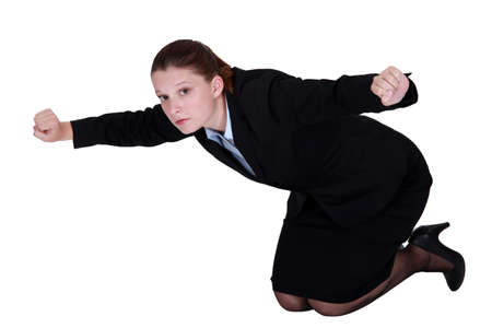Businesswoman kneeling on the floor photo