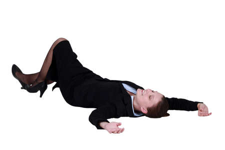 lying on the floor: Businesswoman lying on the floor