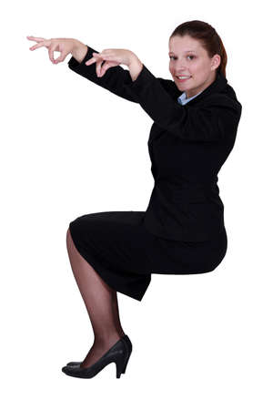 Woman pretending to be puppet master Stock Photo - 14194443