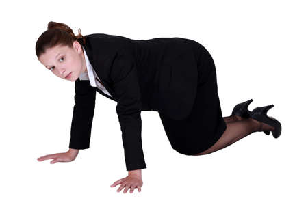skirt suit: businesswoman on all fours