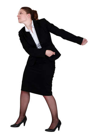 Businesswoman pulling an invisible chain photo