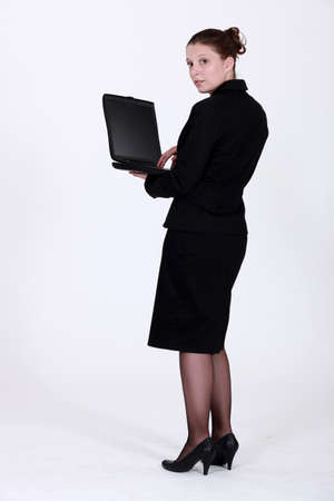 elegant employee holding notebook Stock Photo - 14194655