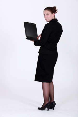 elegant employee holding notebook photo