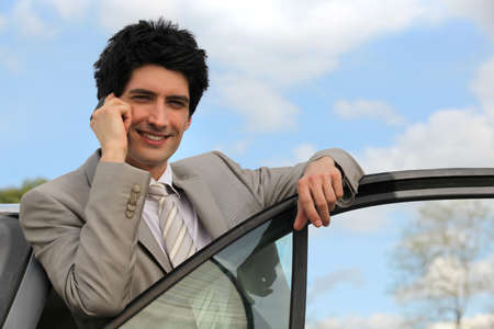 Man using mobile in his car Stock Photo - 14195030