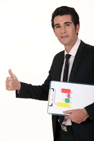A businessman giving the thumb up. photo