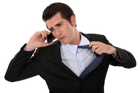 fidgety: Man eager to end a telephone conversation